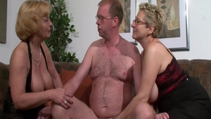 Busty mature receives orgy