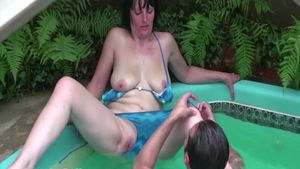 Hairy MILF fisting in the garden