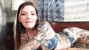 Solo tattooed Penny Archer amateur posing