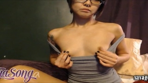 Squirts escorted by petite babe wearing glasses