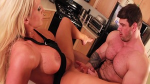 Alura Jenso bends over in the kitchen