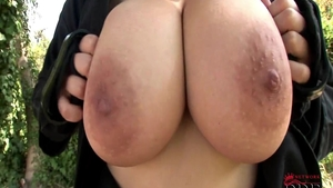 Big tits Shione Cooper teasing outdoors